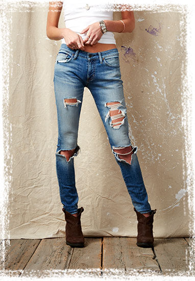 Light-wash skinny jean with rips at the thighs & knees
