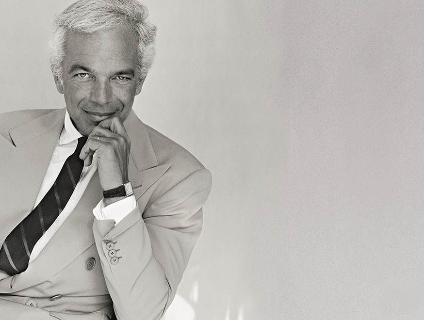 Black & white photo of Ralph Lauren in suit & tie