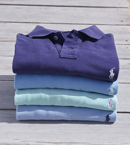 Neat stack of folded purple, blue & light green Polo shirts